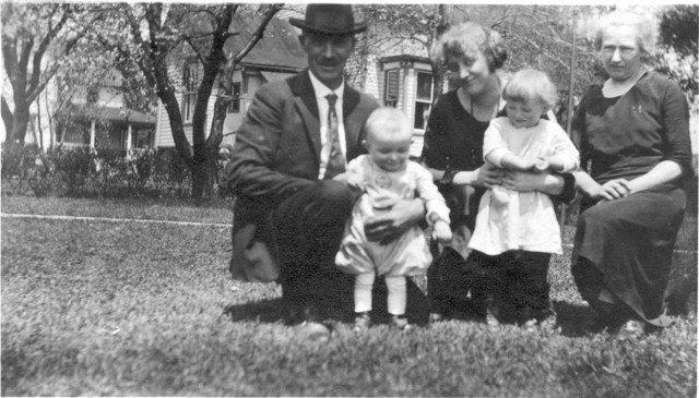 1923: Frank W. Duntemann (in hat), Sade Prendergast Duntemann (Frank's daughter-in-law) center, Martha Winkelmann Duntemann, Frank's wife, at right. Frank holds his grandson Frank W., and Sade holds her daughter Kathleen. Photo taken in Frank's front yard at Orchard Place, Illinois.