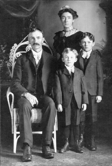 Frank W. Duntemann and Martha Winkelmann Duntemann with their sons Harry G. and Elvin F. Duntemann. Date unknown but by the boys' ages probably 1898-1900.