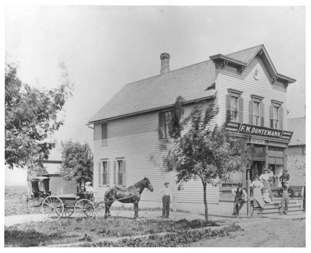 1897: Orchard Place post office and general store. Frank W. and Martha Winkelmann Duntemann are by the lamp post. Harry G. and Elvin F. Duntemann are the smal boys in the horse cart. Herman Duntemann is the man to the right of the horse cart. Today, this location would be just north of Higgins Road and just east of Mannheim Road in what is now Des Plaines, Illnois. The site of the building is now under the Northwest Toll Road.