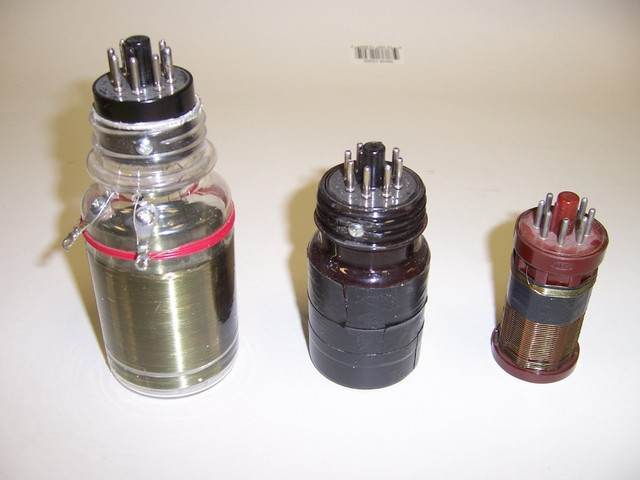 Three examples of plug-in coils for homebrew shortwave receivers. The two on the left are made from vitamin bottles with bases from defunct octal tubes. (Note that the center one has not yet been wound.) The one on the right is a commercial Bakelite form, though I don't know where it was originally sold.