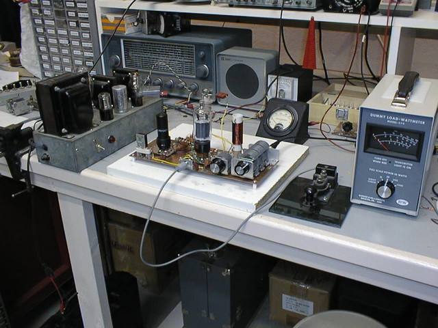 9/97: This is a PC board lashup of a 6DQ5 CW transmitter for 40M. I never transferred the design into a box; in fact, I don't recall writing down the details of the circuit. Worked well, and put out more power than a 6L6 in a similar circuit. The power supply in a galvanized iron box is also home-brew, and put out 440VDC plus AC filament feeds.
