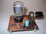 12/2000: A very simple 6T9 Compactron 2-stage audio amp, on a Dremel-hacked PC board. The whole project took a little over an hour.
