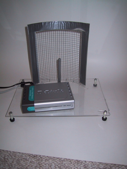 "10/2002: I bent a piece of 1/4"" hardware cloth into a parabola and mounted a Wi-Fi AP in front of it. This greatly increased the range of the AP in one direction, though it was very touchy to adjust."