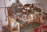 1982: This is my electronics bench/ham shack in Rochester, NY. I put it next to the cold water entry and had a really good earth ground for radio work. It was, of course, a horrible mess at all times.