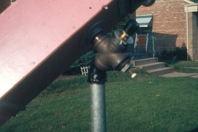 "1968: A close-up of the Springfield mount eyepiece. There's a mirror at the center of the 2"" pipe cross, reflecting light up through the eyepiece. The scope was topheavy, wobbly, and almost impossible to balance, but you could look anywhere in the sky without moving your head."