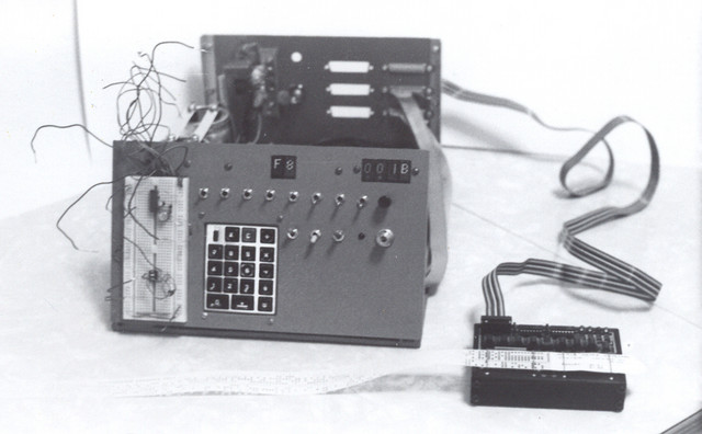 1977: After getting some experience with the original COSMAC Elf, I designed and built a much-expanded version, and constructed it on a discarded Xerox 3100 copier platen cover. It worked very well, and I had an OAM paper tape reader interfaced to it.