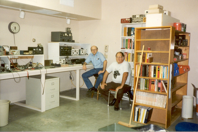 "11/95: George Ewing and I in my Arizona garage/workshop/ham shack, which I had designed and recently completed. It was heavily insulated and air conditioned, with a 2"" conduit for antenna cabling to the roof, and 220V for my lathe."